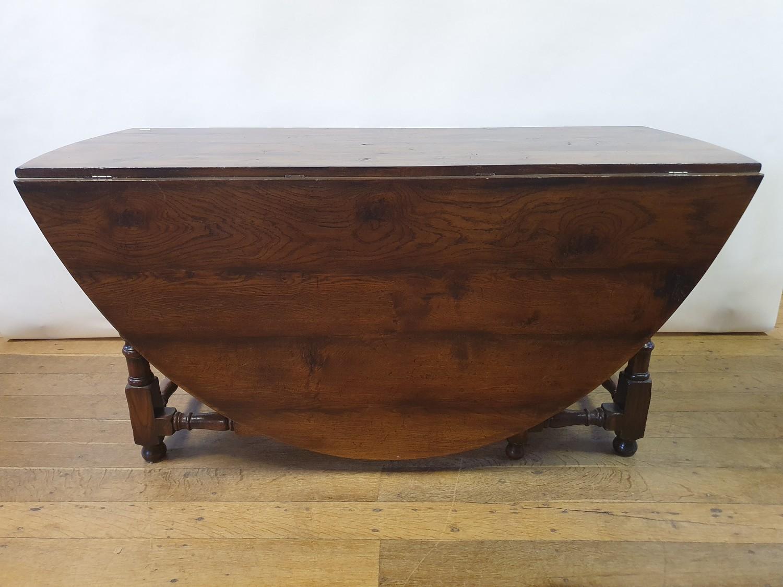 An 18th century style oak gateleg table, 158 cm wide