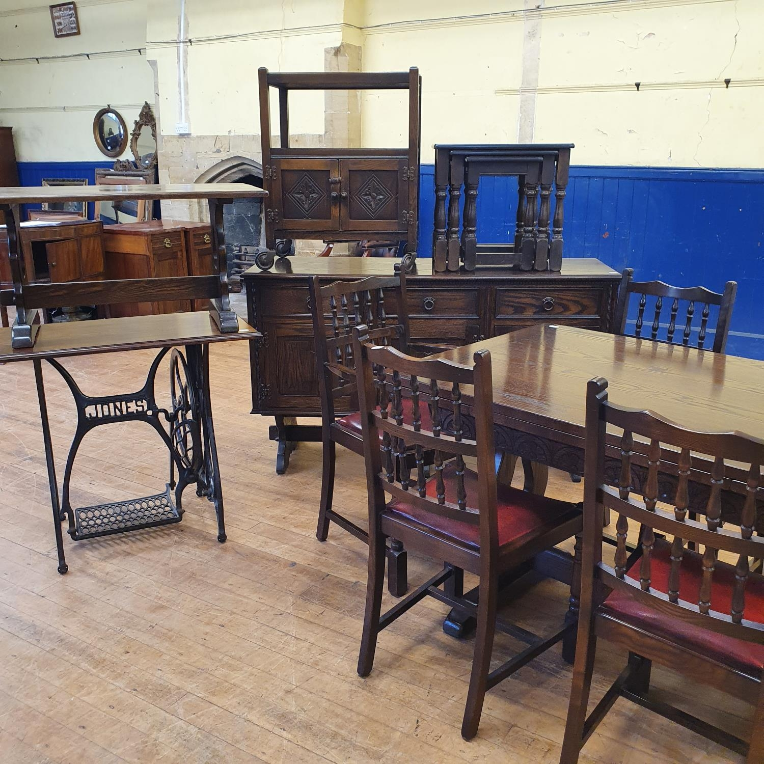 A Jaycee oak dining room suite, comprising an extending dining table, 122 cm wide, a sideboard,
