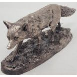 A silvered resin figure, of a fox, 13 cm wide