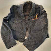 An RAF battle dress jacket, circa 1953, with Observer badge, WWII medal ribbons and Clayesmore CCF