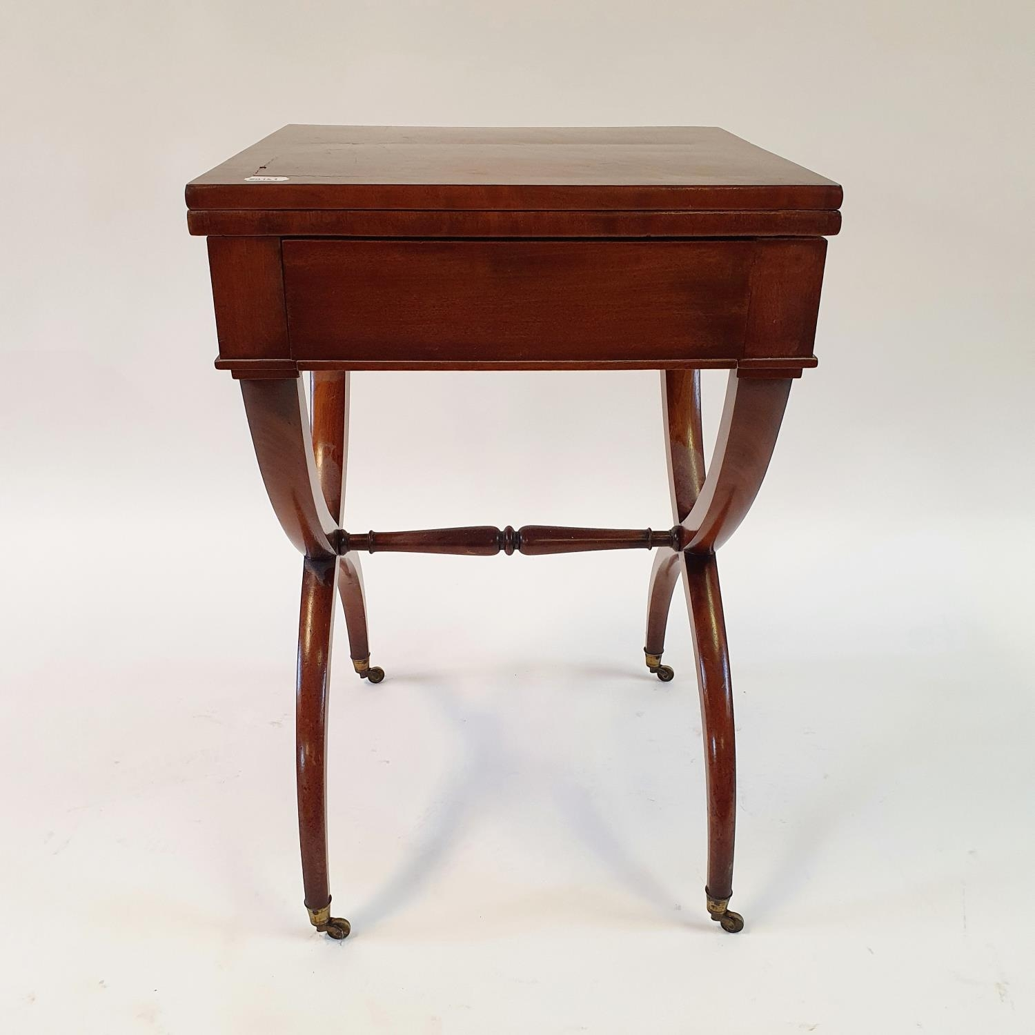 A 19th century mahogany campaign style desk, with folding top to reveal a tooled red leather writing