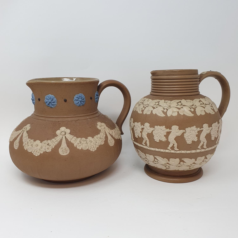 A Doulton Lambeth tobacco jar, 15 cm high, and two Doutlon Lambeth jugs (3) - Image 4 of 7