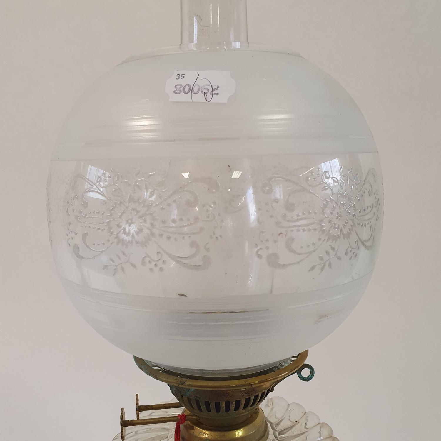 An oil lamp, with an acid etched glass shade, a clear glass well, on a brass base in the form of a - Image 3 of 3