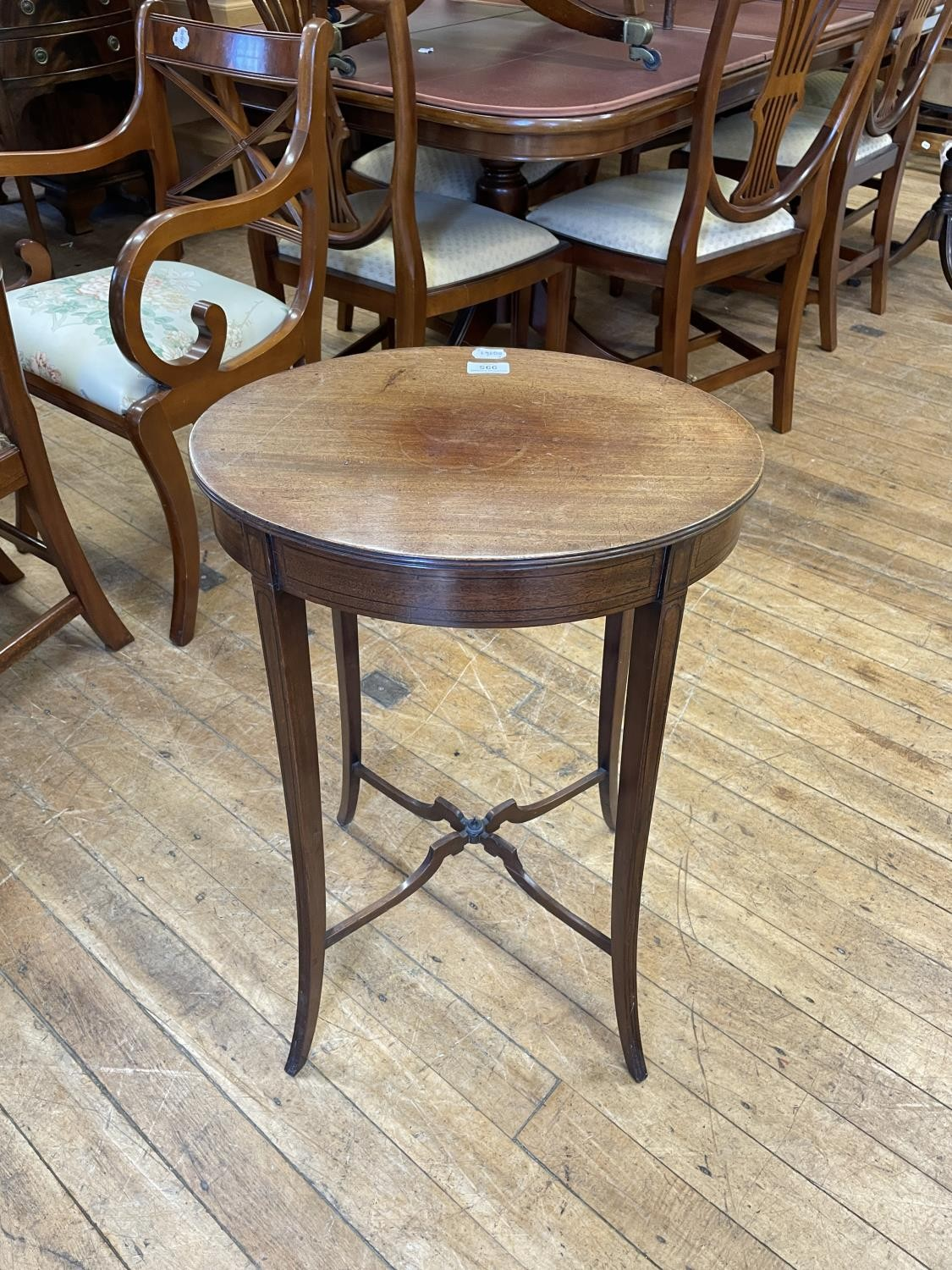 An early 20th century mahogany oval table, on splayed legs united by an X stretcher, 47 cm wide