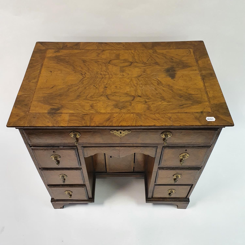 An 18th century style walnut kneehole desk, with herringbone crossbanding, having, having one long - Image 3 of 11
