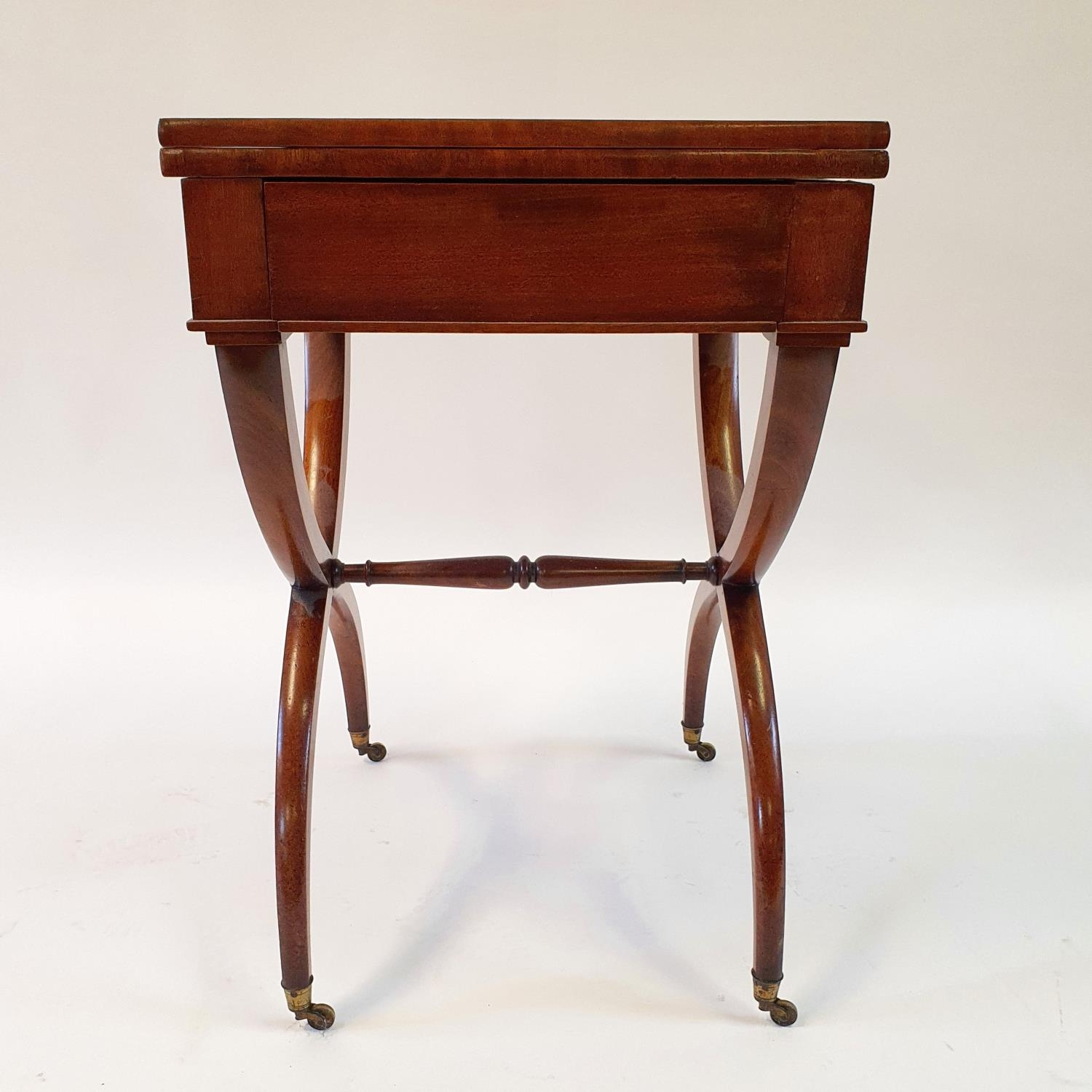 A 19th century mahogany campaign style desk, with folding top to reveal a tooled red leather writing - Image 4 of 6