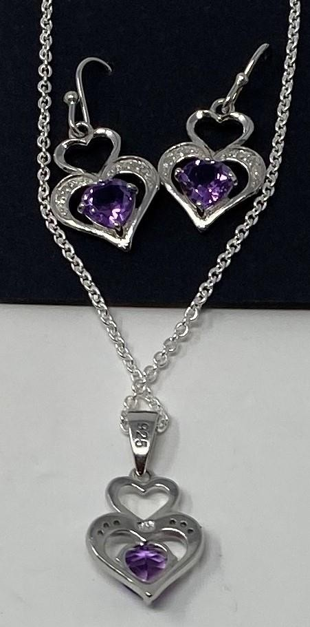 A pair of silver, amethyst and diamond set earrings, and a matching necklace This is a modern copy