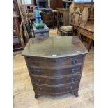 A mahogany bow front chest, having four long drawers, 66 cm wide