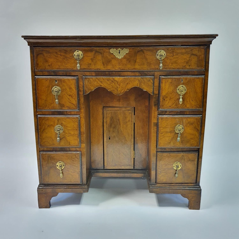An 18th century style walnut kneehole desk, with herringbone crossbanding, having, having one long - Image 2 of 11