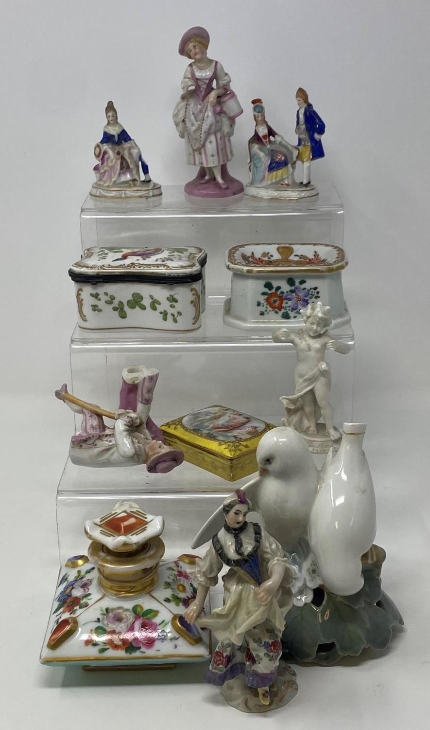 A Continental porcelain perfume bottle, decorated flowers, 8 cm wide, a porcelain box, 8 cm wide and