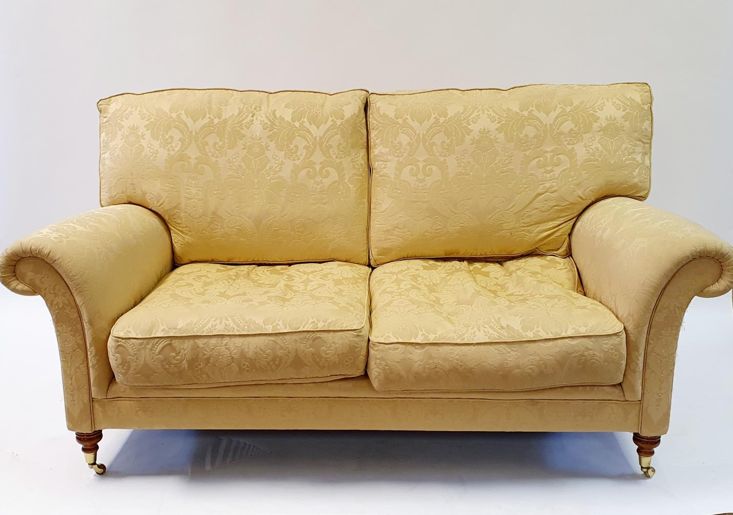A Wesley Barrell Victorian style two seater settee, on turned front legs