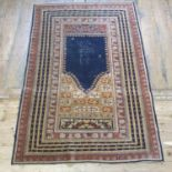 A Persian prayer mat, multiple borders, 198 x 135 cm and A Persian red ground prayer mat, with