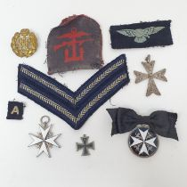 An Order of St John neck badge, a breast badge, and a small group of militaria items