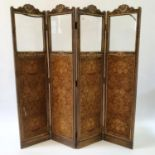 An early 20th century painted four panel screen, the top with glazed sections above silk panels