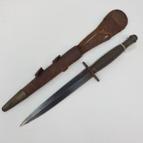 A Fairbairn & Sykes type Commando fighting knife, with a ribbed handle, and a leather scabbard