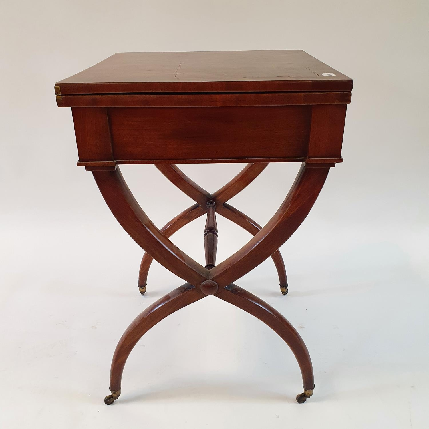 A 19th century mahogany campaign style desk, with folding top to reveal a tooled red leather writing - Image 6 of 6