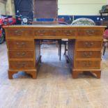 A modern pedestal desk, 135 cm wide, and a mahogany gateleg table (2)