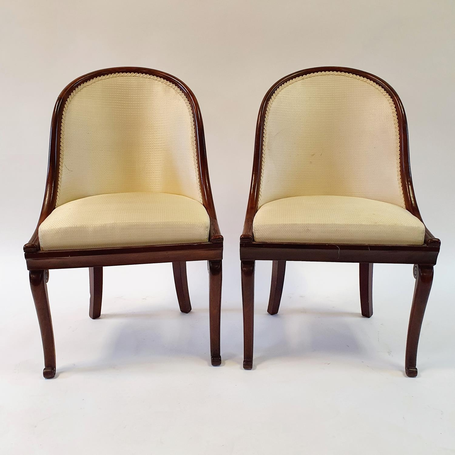 A pair of 19th century mahogany hoop back chairs, of small proportions, on cabriole legs (2) Signs