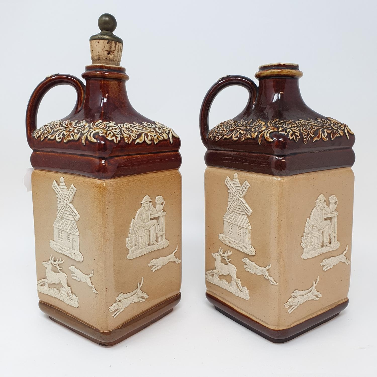 A pair of Doulton Lambeth flagons, impresses Supplied to G.W. Scott & Sons Only and two Doulton