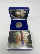 A Queens Coronation 60th Anniversary silver proof £5 coin, 2013, and five other proof coins, all
