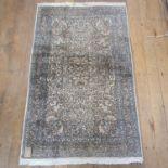 A Perisan silk Kashan rug, 186 x 117 cm