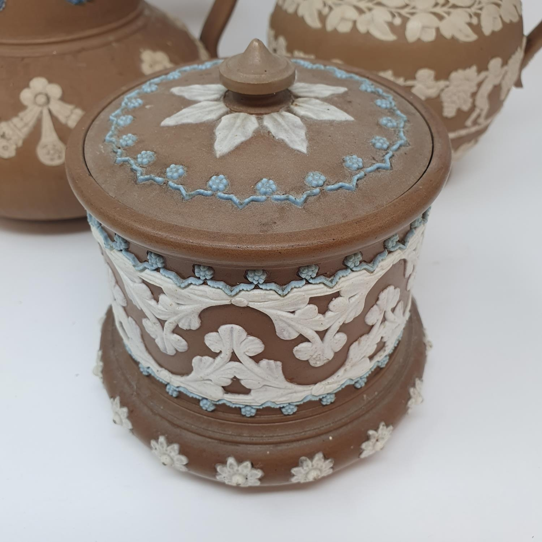 A Doulton Lambeth tobacco jar, 15 cm high, and two Doutlon Lambeth jugs (3) - Image 2 of 7