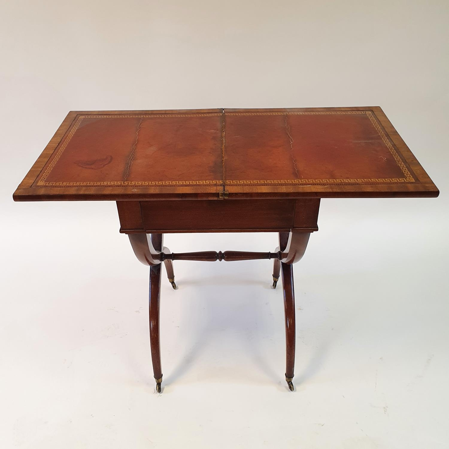A 19th century mahogany campaign style desk, with folding top to reveal a tooled red leather writing - Image 2 of 6