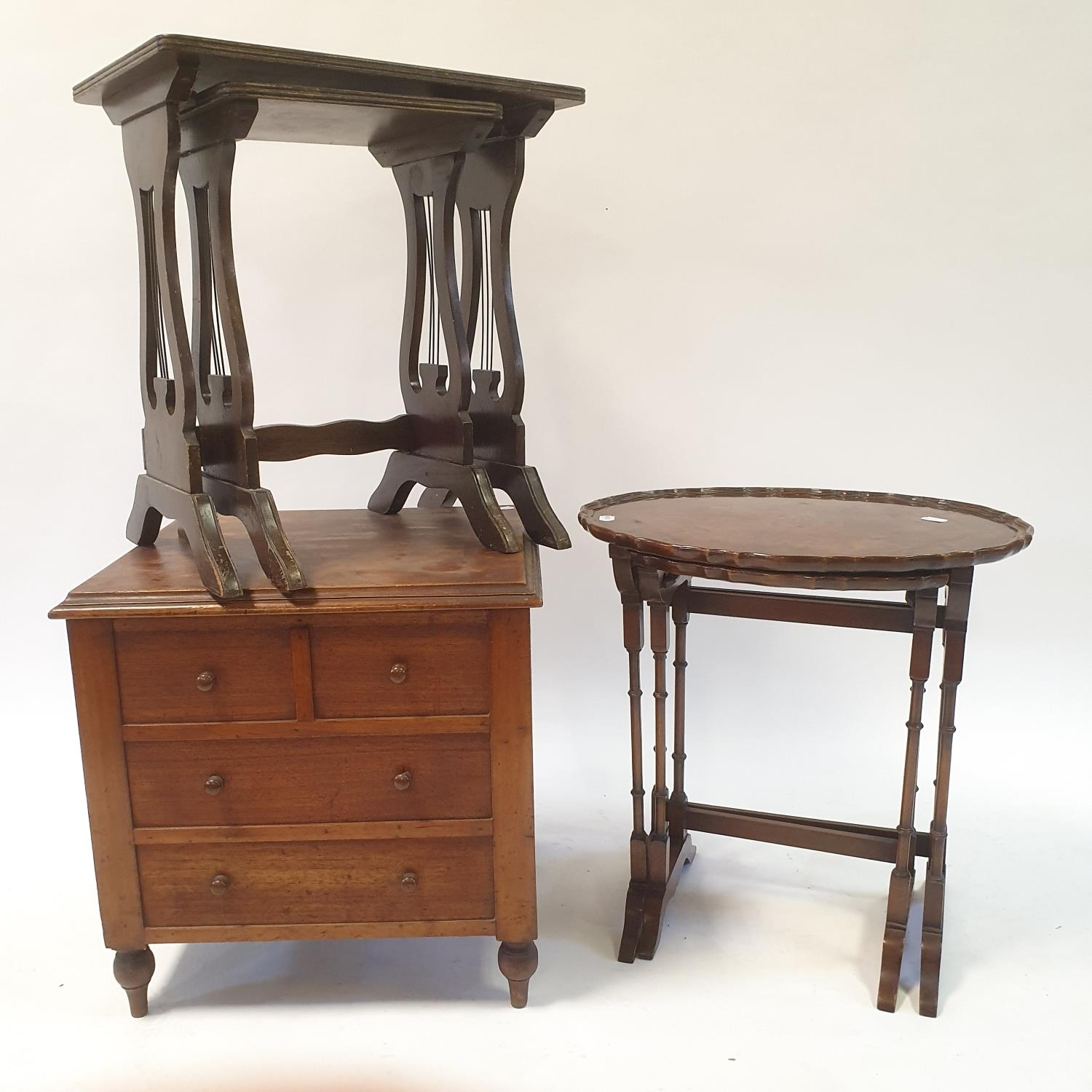 A 19th century mahogany wine table, 53 cm diameter, a commode, two nests of two tables, and a