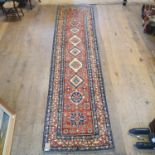 A Persian type red ground runner, with main cream border, centre with repeating medallions, 356 x 90
