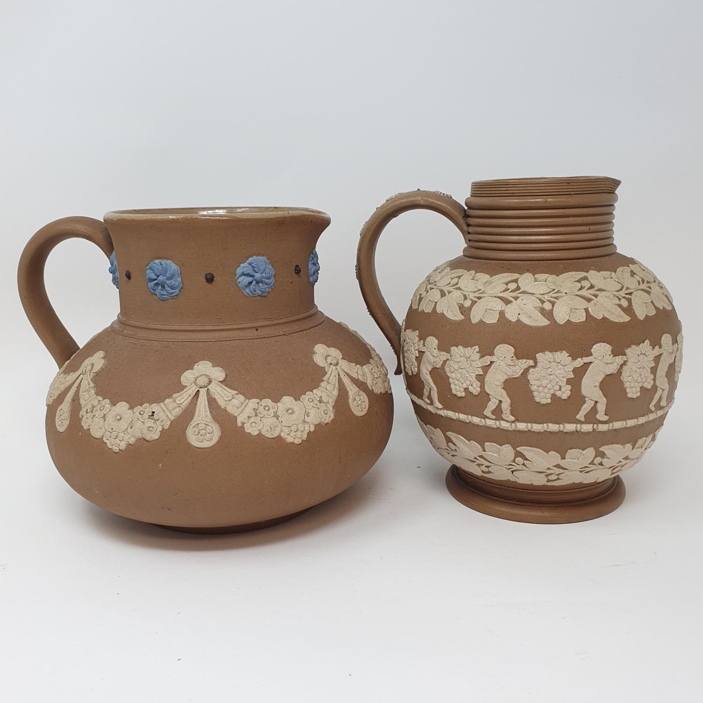 A Doulton Lambeth tobacco jar, 15 cm high, and two Doutlon Lambeth jugs (3) - Image 5 of 7