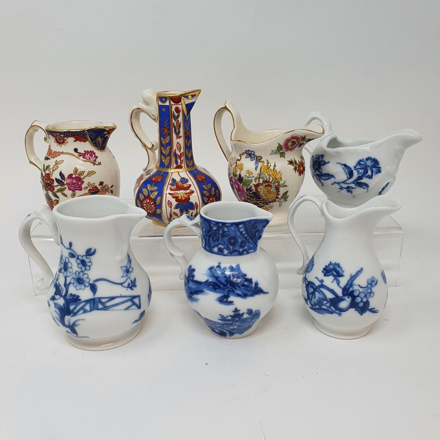 A Royal Doulton figure Dinky Do, HN1678, seven modern Royal Worcester blue and white cream jugs - Image 3 of 5