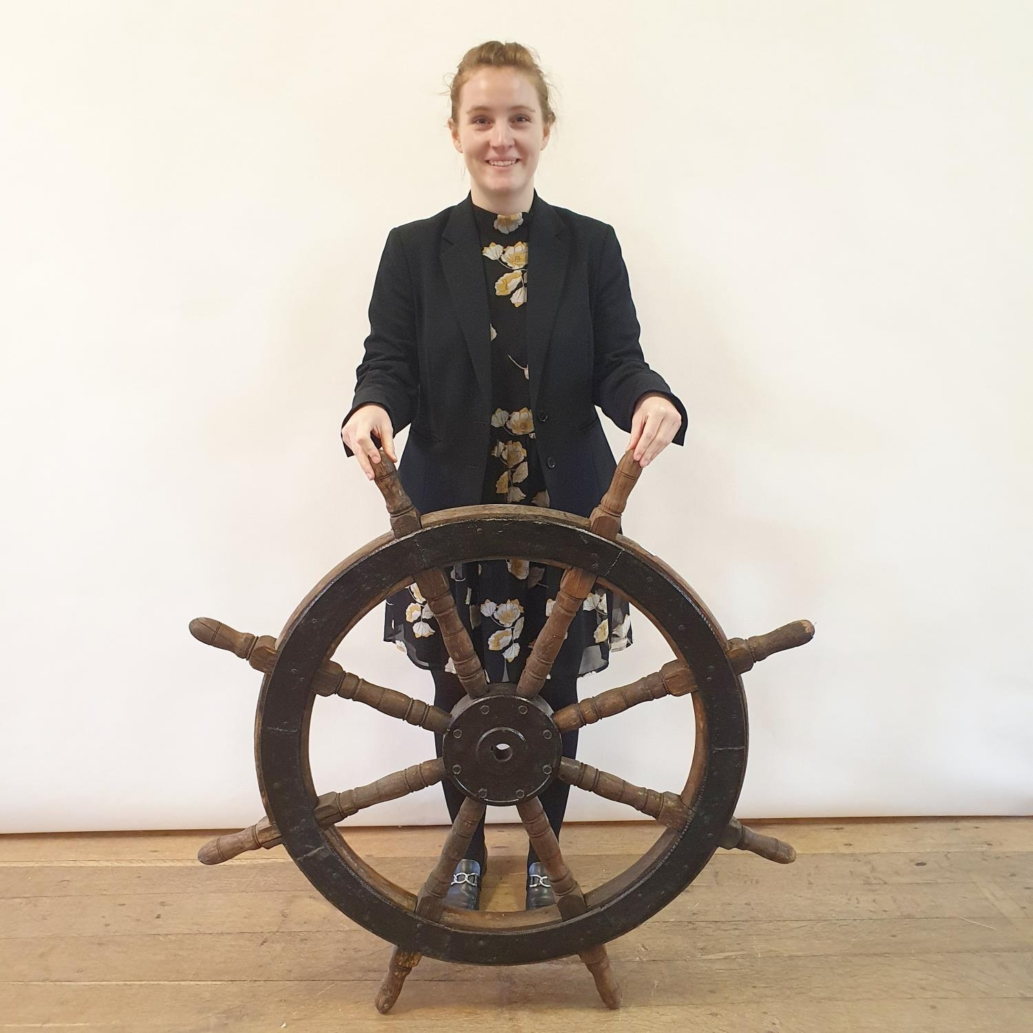 A ships wheel, with painted metal mounts, 107 cm diameter