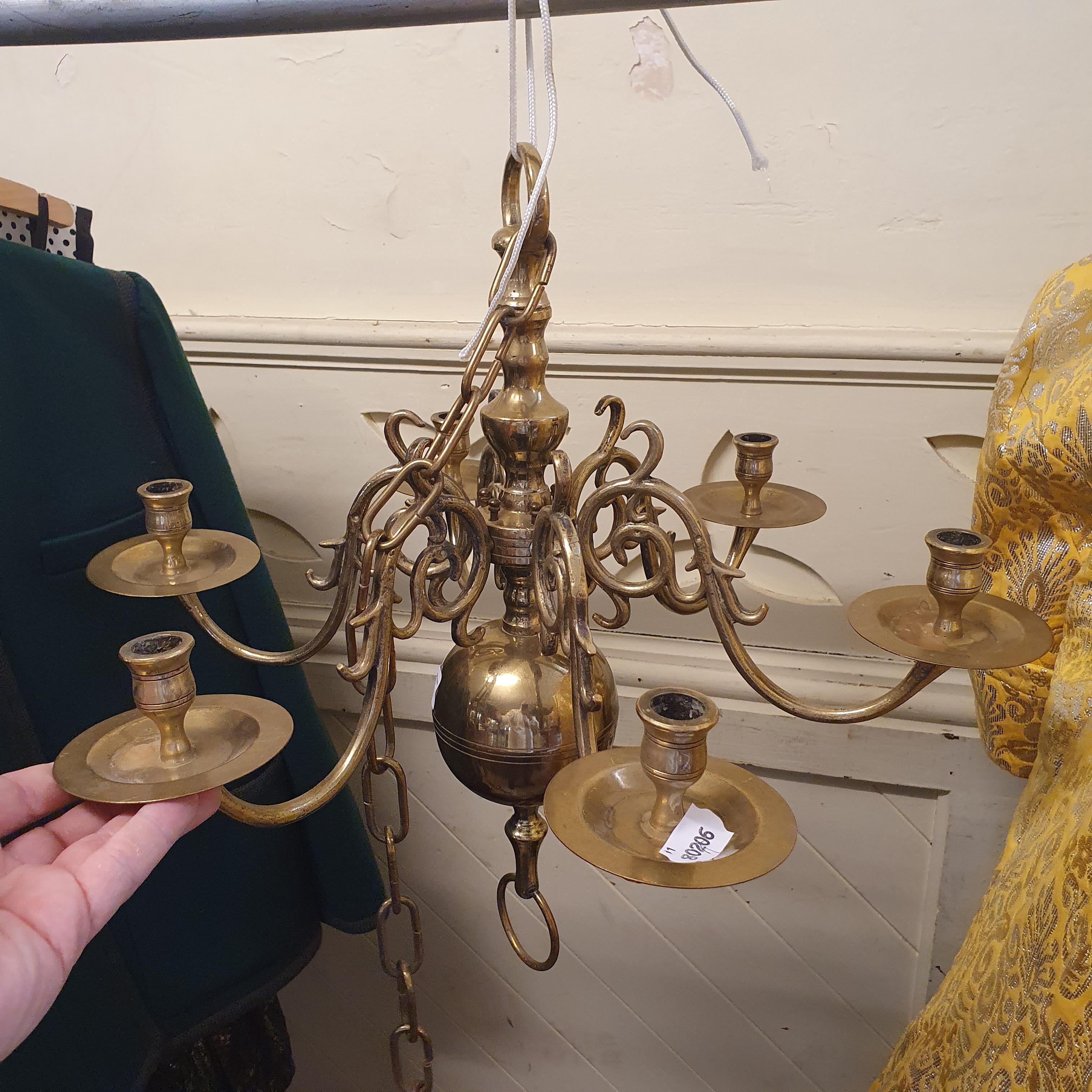 A Dutch style brass six branch chandelier, 50 cm diameter