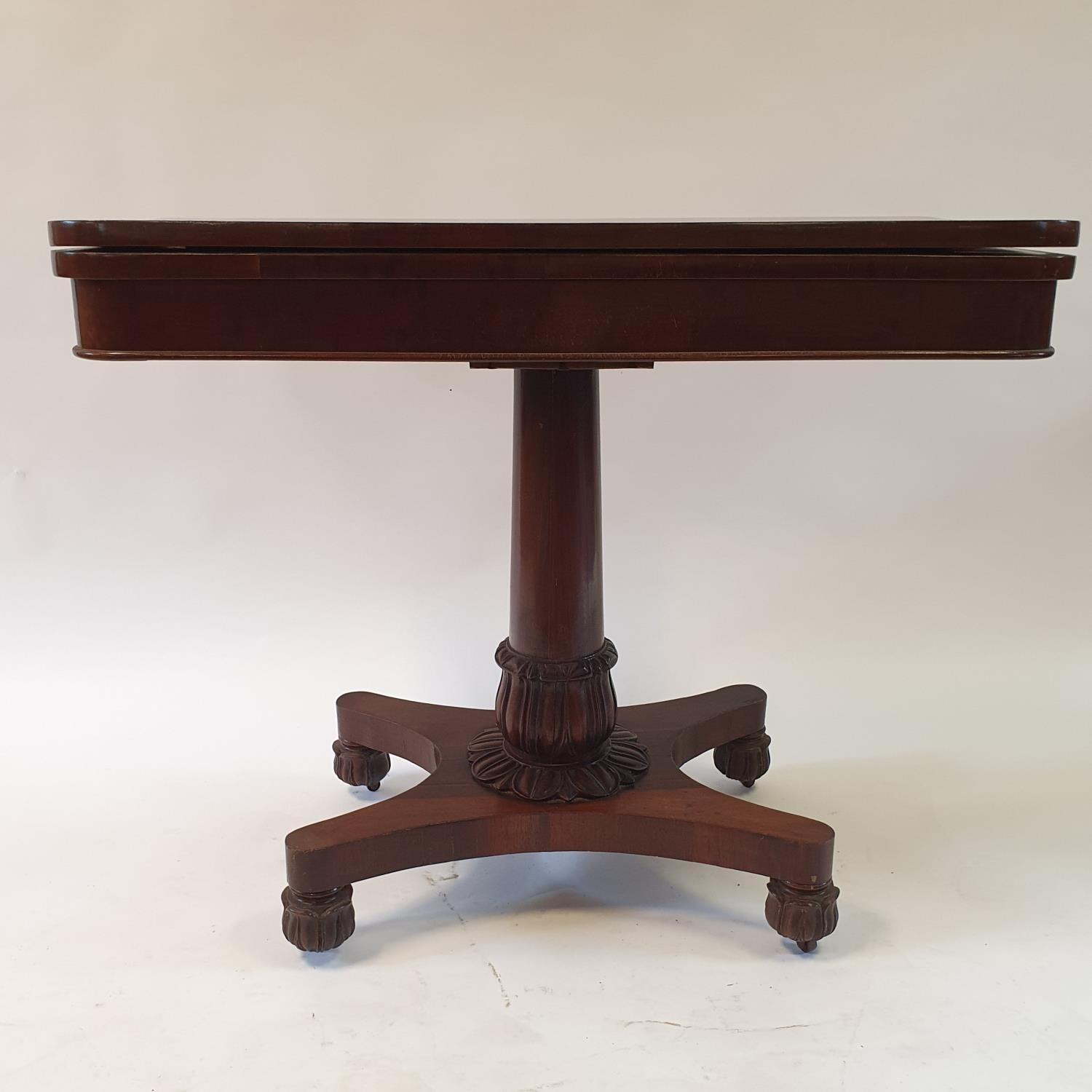 A mahogany plum pudding folding card table, on carved column support to shaped base on carved bun - Image 2 of 4