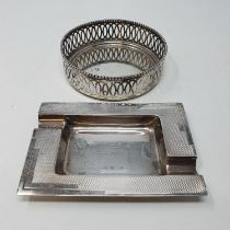 A silver ashtray, Sheffield, 1937 and a Continental silver coloured metal bottle coaster (2) 7tozs