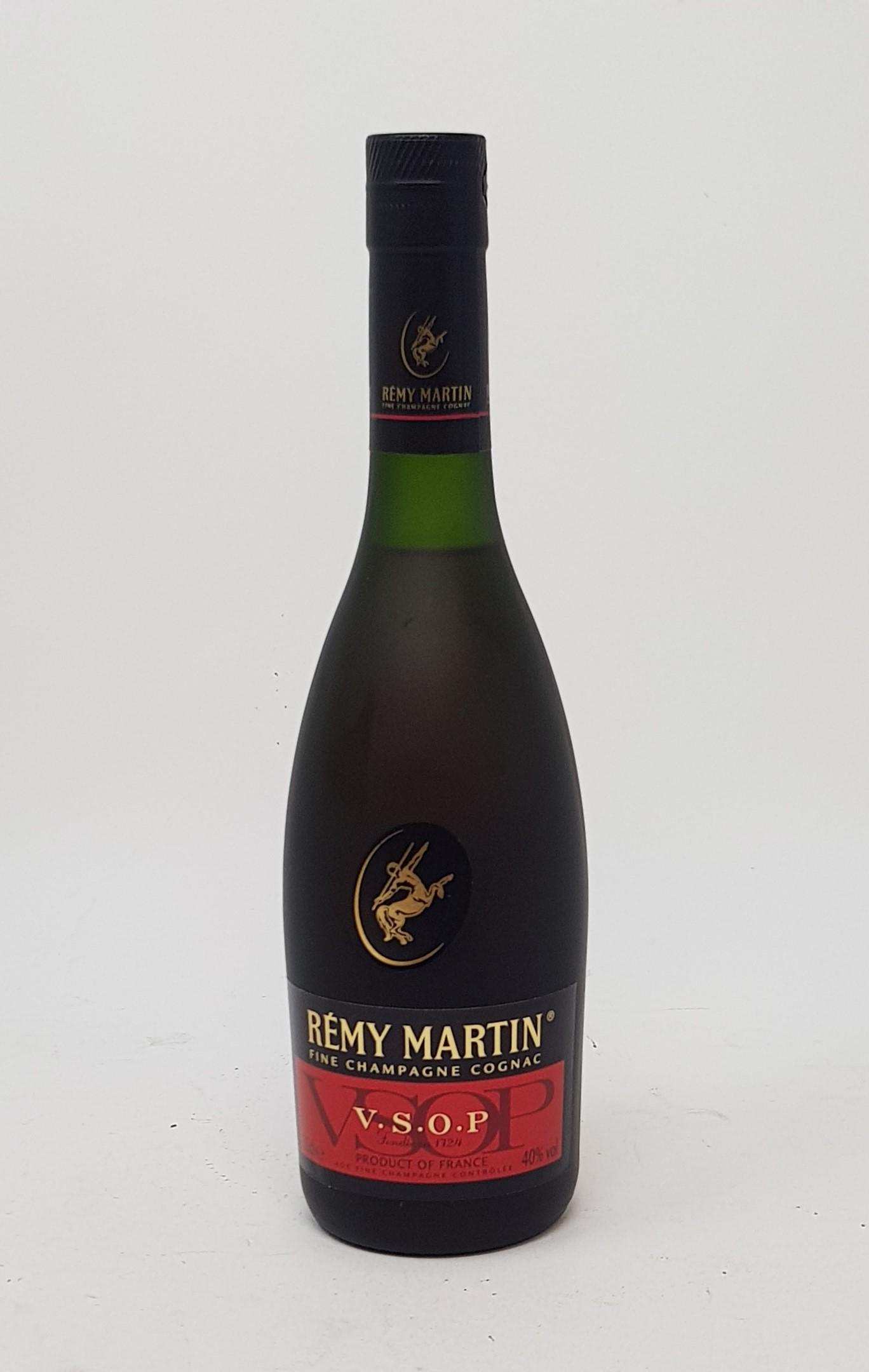A 70cl bottle of Belle Vue Armagnac, a 350ml bottle of Remy Martin cognac, and a 70cl bottle of - Image 3 of 4