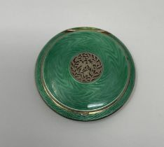 An Austrian silver guilloche and green enamel compact, the pierced top decorated flowers and