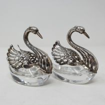 A set of two Continental silver and cut glass salts, in the form of swans, another in silver
