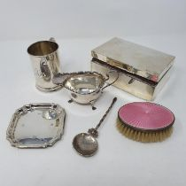 A George V silver mug, engraved Nancy, a cigarette box, a silver backed brush, a spoon, a pin