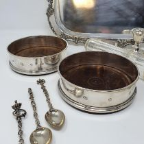A pair of silver bottle coasters, with turned wooden bases, London 1981, 12.5 cm diameter, set of