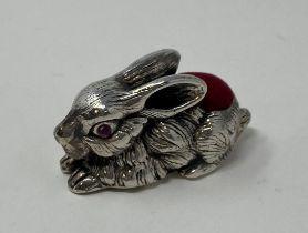 A silver rabbit pin cushion This is a modern copy