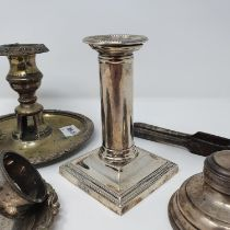 A George V candlestick, in the form of a column, Sheffield 1910, a capstan inkwell, two napkin