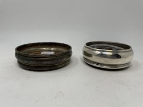 A silver and mahogany bottle coaster, London 1990, and another, London 1973, 11 cm diameter (2)