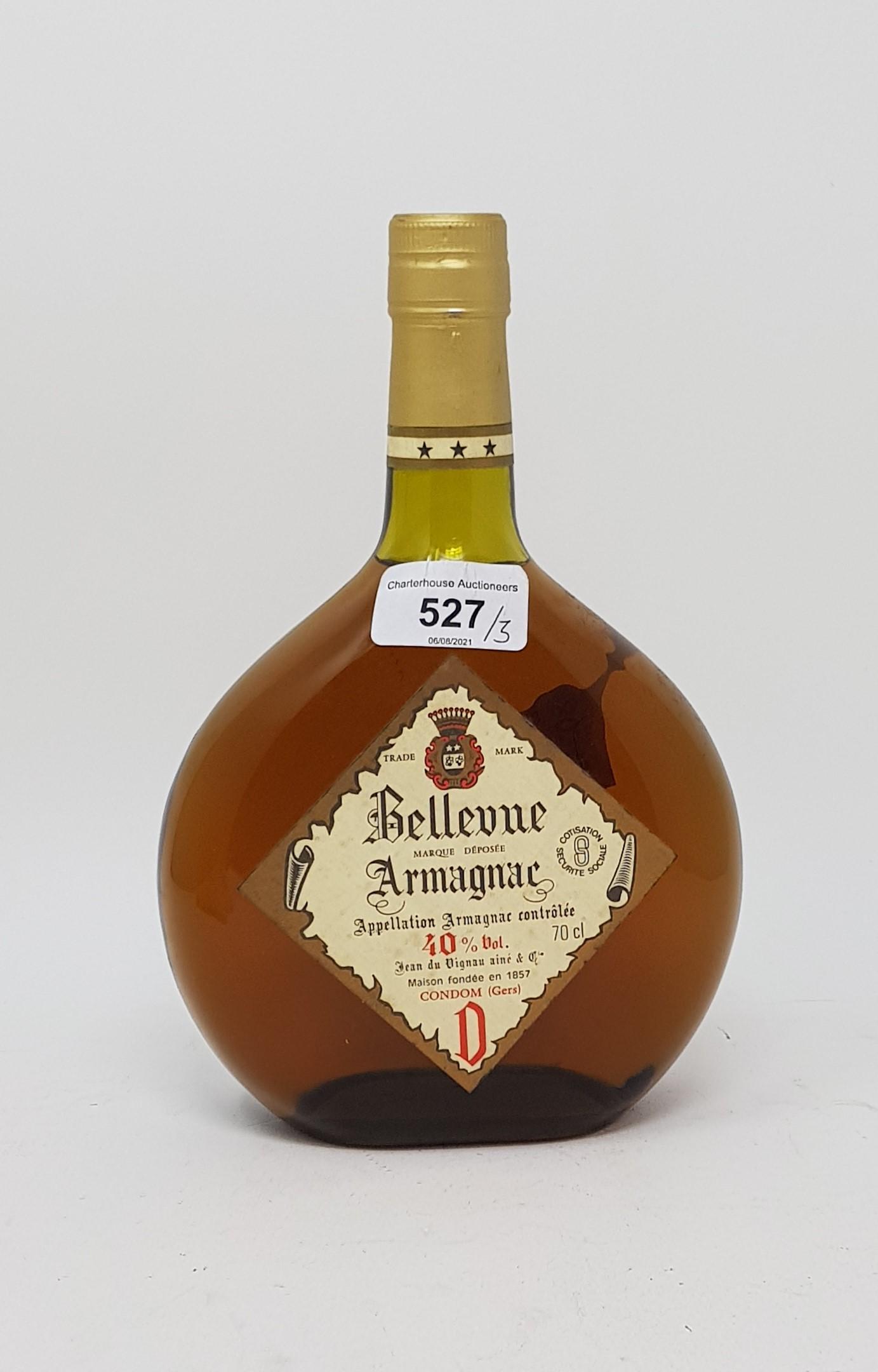 A 70cl bottle of Belle Vue Armagnac, a 350ml bottle of Remy Martin cognac, and a 70cl bottle of