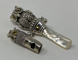 A silver owl rattle, with a mother of pearl bite and an owl whistle (2) This is a modern copy