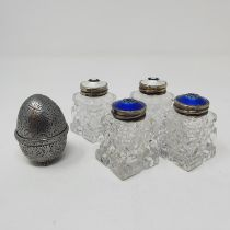A pair of Continental cut glass inkwells, with silver coloured metal and blue enamel tops, another