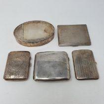 A George V silver cigarette case, Birmingham 1922, three cigarette cases and a silver coloured metal