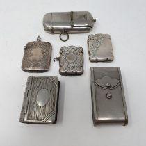 A George V vesta, Birmingham 1912, two silver vestas and three silver plated vestas (6)