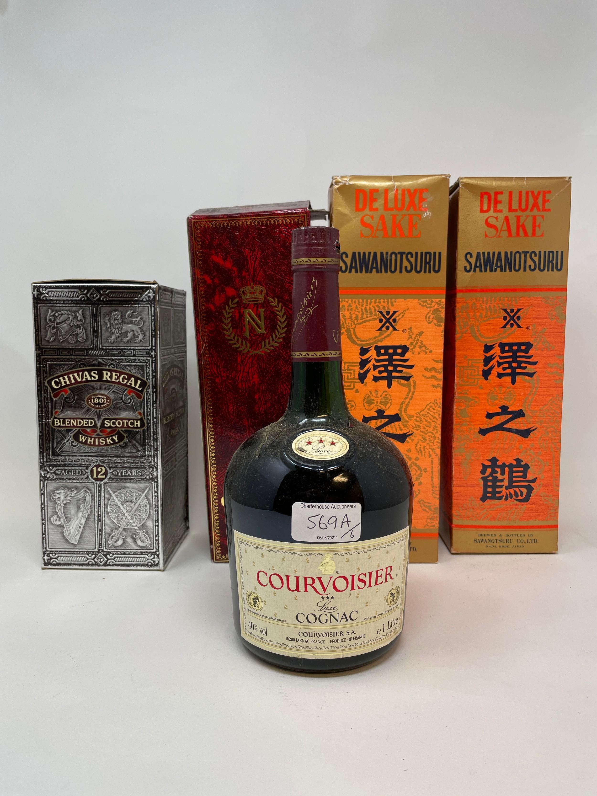 A bottle Camus Napoleon cognac, a bottle of Chivas Regal whisky, a bottle of Courvoisier cognac