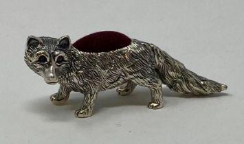 A silver fox pin cushion This is a modern copy
